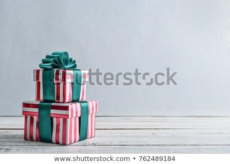 dourado · papel · de · embrulho · arco · apresentar · decoração · natal - foto stock © zhekos