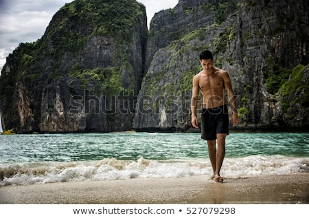 Young athlete boxer at beach Stock photo © curaphotography