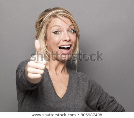 woman giving the OK Stock photo © grafvision