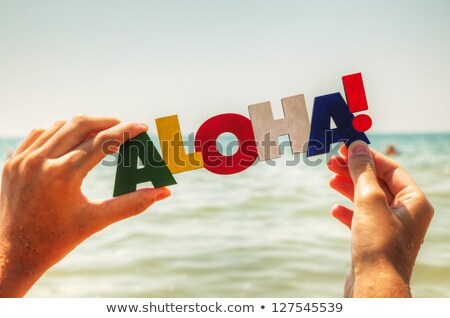 Female's hand holding colorful word 'Aloha' Stock photo © AndreyKr