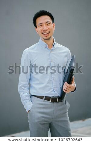 grey haired man holding folder stock photo © photography33