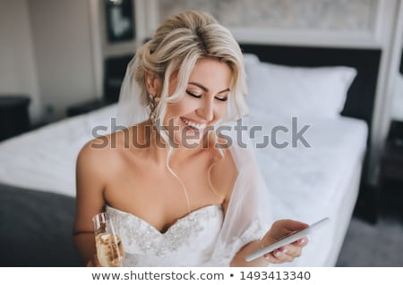 Stock photo: Fashion smiling bride in wedding white dress - curly hairstyle