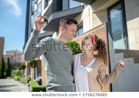 Excited young man holding the keys to his new place Stock photo © photography33