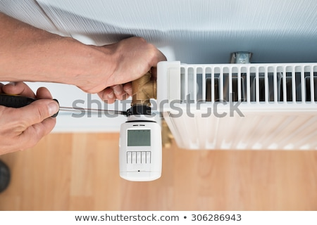 Plumber with a thermostatic radiator valve Stock photo © photography33