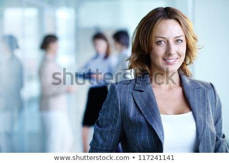 Bájos üzletemberek mosolyog kamera igazgató üzletasszony Stock fotó © wavebreak_media