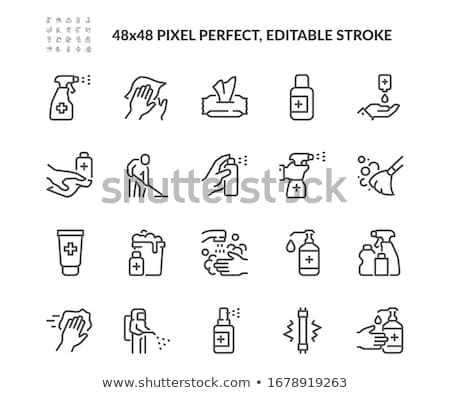 Spray bouteille main bleu liquide plastique Photo stock © Stocksnapper