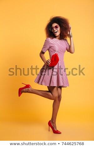 Játékos csinos fiatal nő fekete macskanadrág izolált Stock fotó © acidgrey