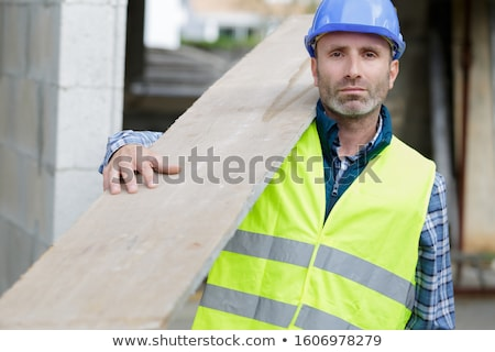 Worker carrying wooden planks Stock photo © photography33