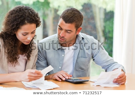 Young couple calculating their domestic bills at home Stock photo © wavebreak_media