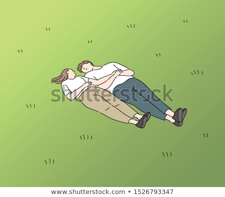 Happy couple lying down in the park Stock photo © wavebreak_media