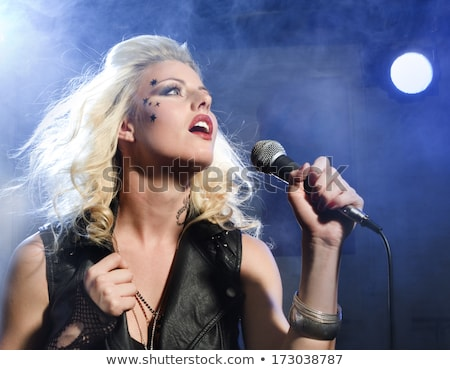 Beautiful Blonde Rock Star on Stage Singing Stock photo © tobkatrina