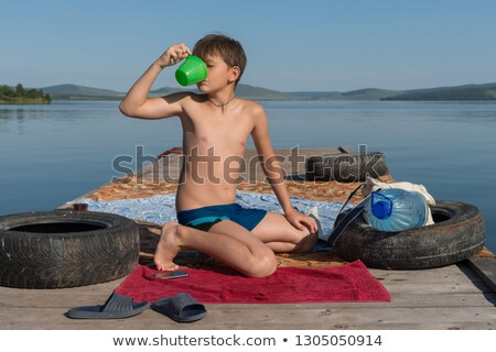 Young Boy Slaking his Thirst Stock photo © ozgur