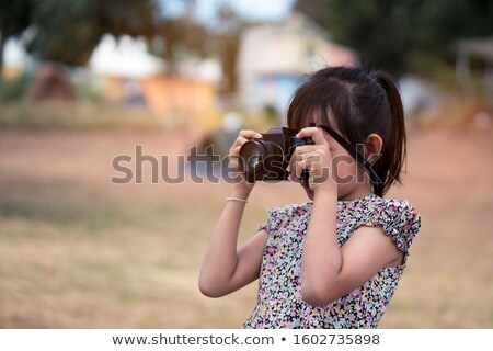 Teen cutie with vintage camera. Stock photo © lithian