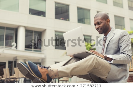 laptop man smiling happy using computer outside stock photo © maridav