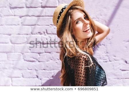Gracioso loiro mulher jovem posando blusa branca Foto stock © acidgrey