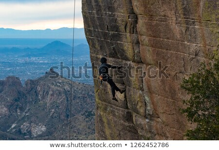 Breath-taking rock climber. foto stock © gregepperson