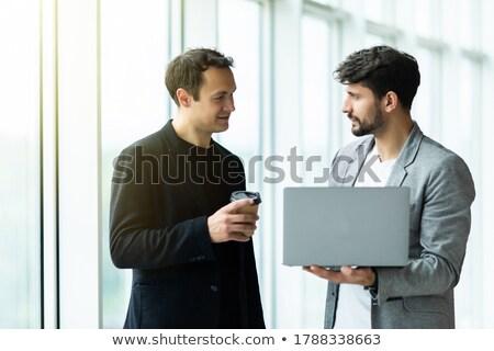 Empresario ordenador portátil aislado blanco hombre portátil Foto stock © Kurhan