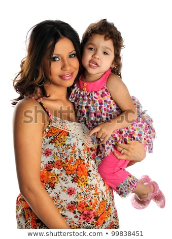 portrait of hispanic pregnant woman with daughter isolated over stock photo © dacasdo