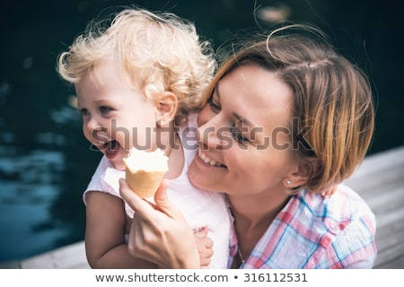 beautiful toddler eating ice cream mother care stock photo © lunamarina