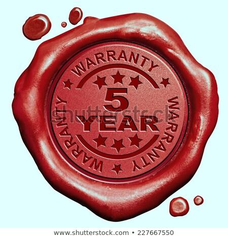 warranty 5 year   stamp on red wax seal stock photo © tashatuvango