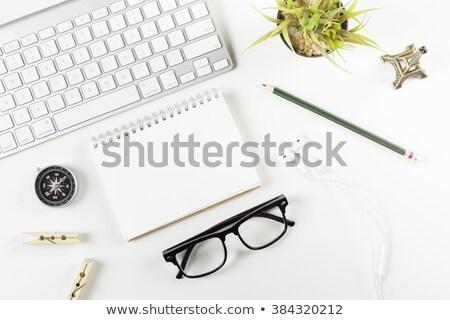 Livre verres souverain boussole crayon mentir Photo stock © cherezoff