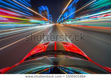 Stockfoto: Red Car Moves Fast On Highway