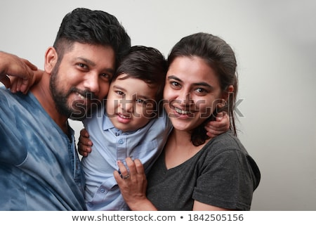 Studio shot of parents and their young son Stock photo © photography33