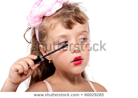 Girl making her eyelashes Stock photo © Witthaya