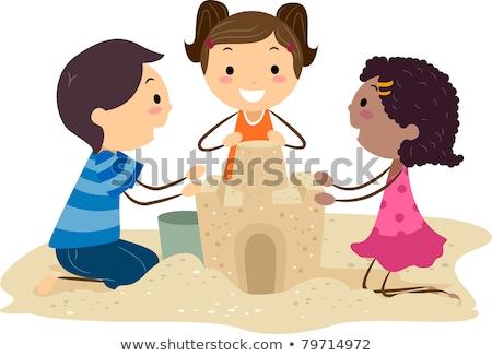 ストックフォト: 男の子 · 海浜砂 · 建物 · 少年 · 美しい · 家族