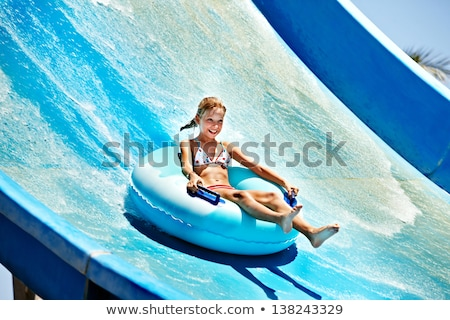 girl in the pool water slide stock photo © mady70