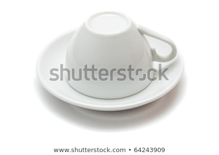 upside down cup over saucer isolated on white background stock photo © mycola