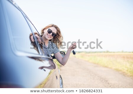 driver smiling sitting in car and showing new car keys  Stock photo © vladacanon