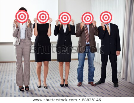 Stock photo: A group of business people in a circle aiming for the target