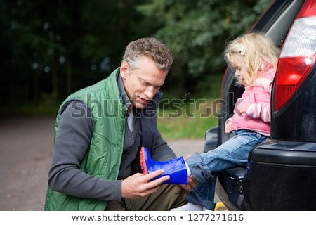 Young Girl Putting On Wellington Boots Stock photo © monkey_business