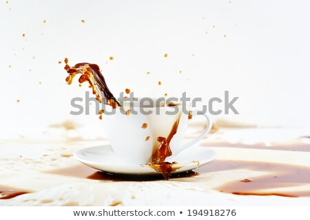 cup of spilling coffee creating beautiful splash stock photo © dariazu