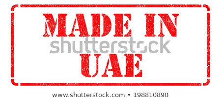 Made in UAE - inscription on Red Rubber Stamp. Stock photo © tashatuvango