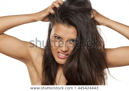 Upset Indian young woman with her head in hands on white background Stock photo © bmonteny