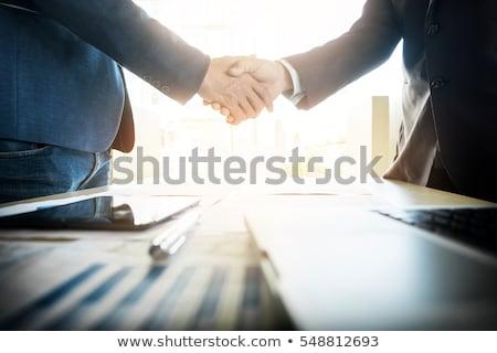 Drżenie rąk dwie osoby mężczyzna kobiet niebieski skóry Zdjęcia stock © michaklootwijk