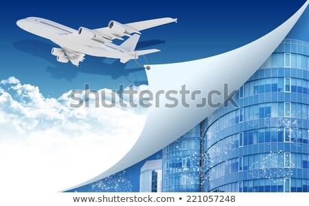 Airplane pulls the rope edge of paper Stock photo © cherezoff