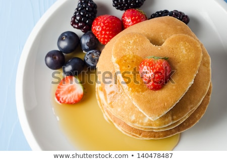 Heart-shaped pancakes with maple syrup and strawberry Stock photo © aladin66