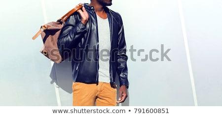 fashion man walking on grey background stock photo © feedough