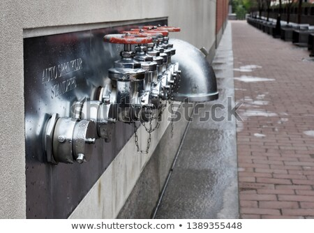 multiple fire department connections on a building wall stock photo © alex_grichenko