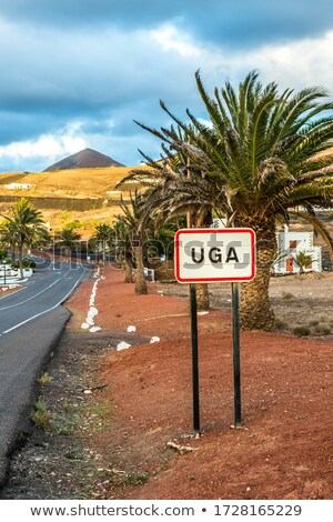 Street sign of village of UGA in evening light Stock photo © meinzahn
