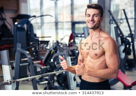 Jóképű férfi izmos test pózol szürke fiatal Stock fotó © deandrobot