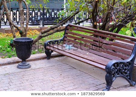 vintage style of public bench for relax in park stock photo © alexmillos