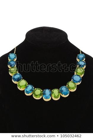 Pendant with green and blue gem stones on black mannequin isolat Stock photo © tetkoren