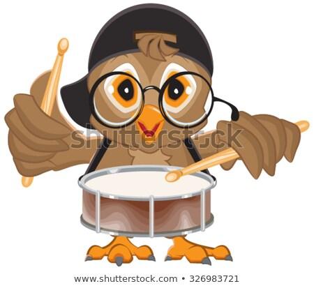 Owl drummer. Owl beats the drum Stock photo © orensila