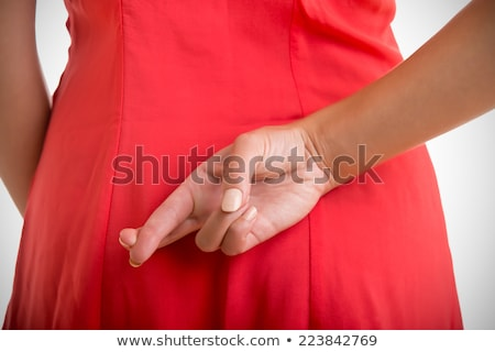 Stock photo: Close up of crossed fingers behind woman's back
