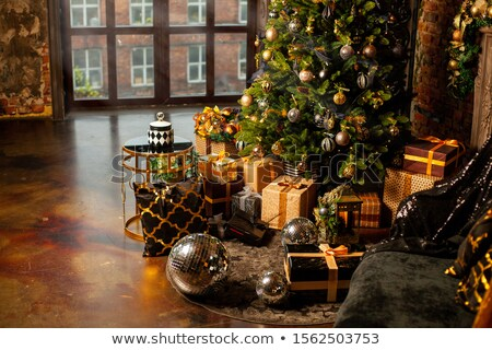 Composite image of christmas tree decorated with golden ornaments Stock photo © wavebreak_media