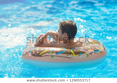 the boy floats in pool stock photo © paha_l